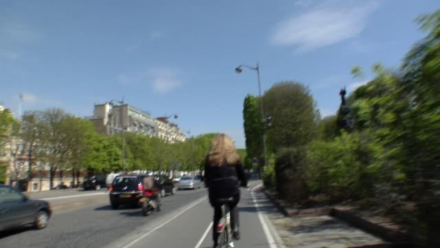 POV Following woman riding on bike lane, Paris, France