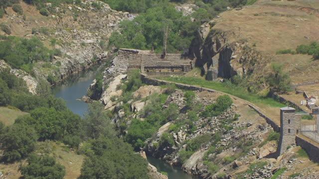 ws zo aerial pov folsom prison, folsom dam in background, california - law stock videos & royalty-free footage