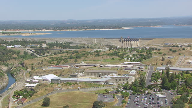 WS AERIAL POV Folsom Prison, Folsom Dam in background, California