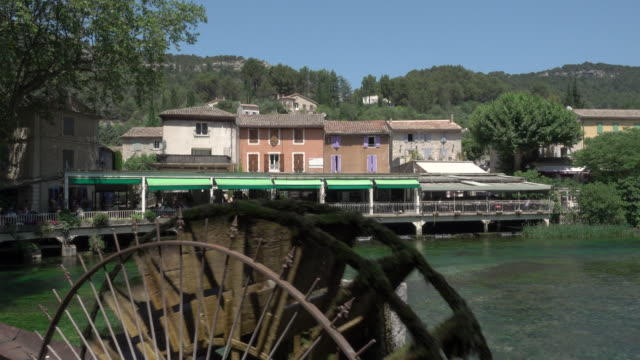 fontaine de vaucluse tracking shot restaurants - water wheel stock videos and b-roll footage