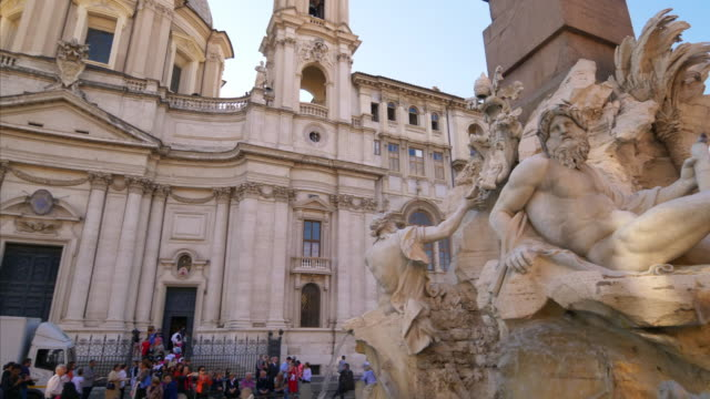 fontana dei quattro fiumi a water fountain in piazza navona in rome, italy - piazza navona stock videos & royalty-free footage