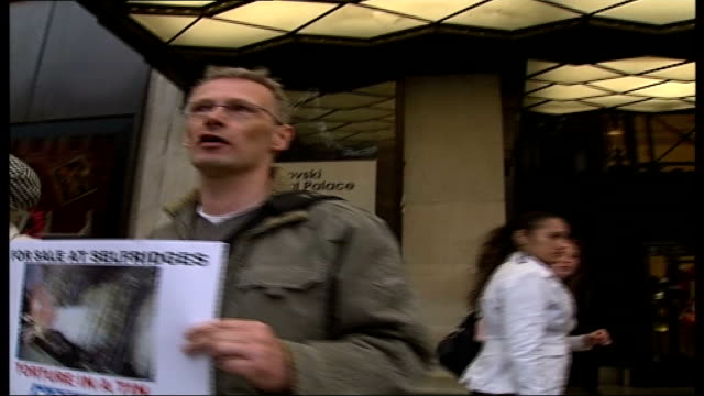 campaigners want to stop sale of foie gras in britain london ext animal rights' protesters with posters chanting outside selfridges store selfridges... - gras stock videos and b-roll footage
