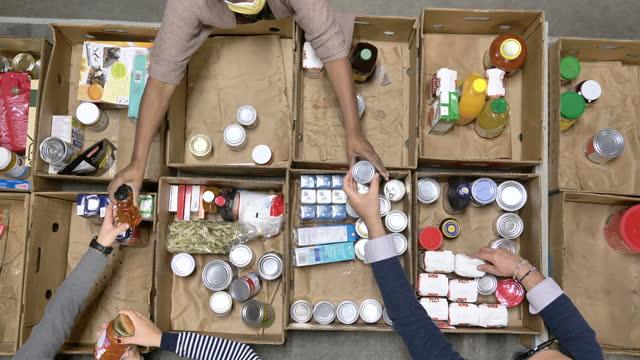 food bank volunteers - fatcamera stock videos & royalty-free footage