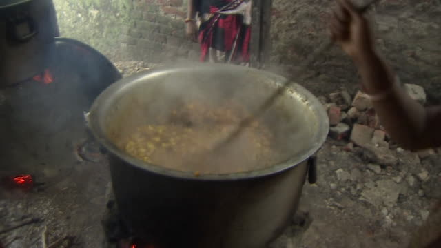 Food being cooked and provided for victims of flooding in Bihar India