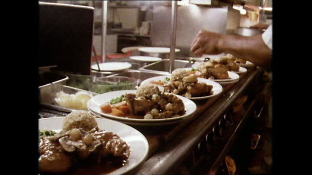 food being plated up and served in restaurant; 1983 - 1983 stock videos & royalty-free footage
