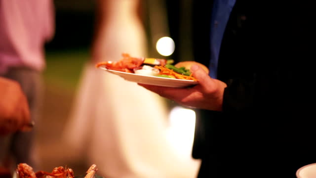 Food buffet catering dining outdoor party at night.