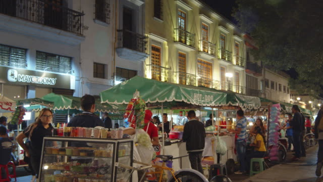 food carts and stalls at a night market in oaxaca, mexico - evening meal stock videos & royalty-free footage