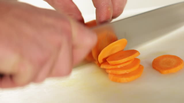 ms food chef chopping carrot / sao paulo, brazil - carrot stock videos and b-roll footage