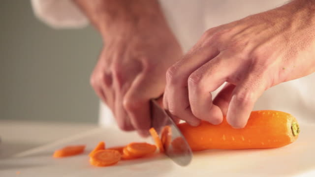 ms food chef chopping carrot / sao paulo, brazil - carrot stock videos & royalty-free footage