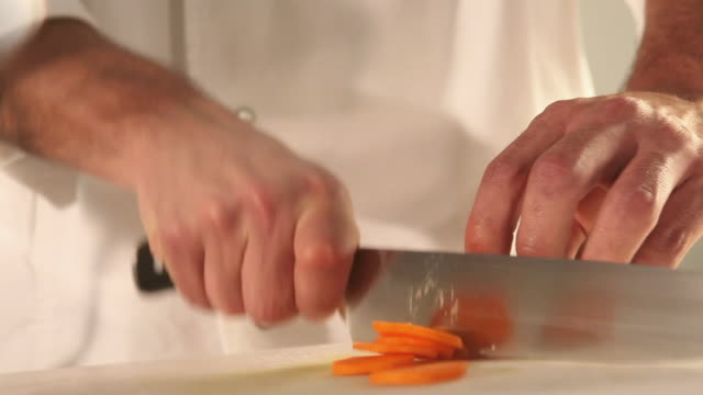 ms food chef chopping carrot / sao paulo, brazil - möhre stock-videos und b-roll-filmmaterial