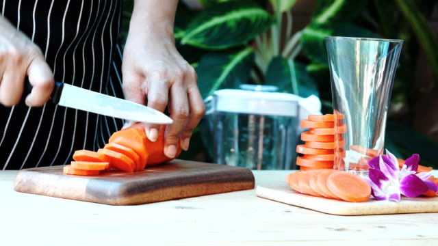 food chef chopping carrot - cut video transition stock videos & royalty-free footage