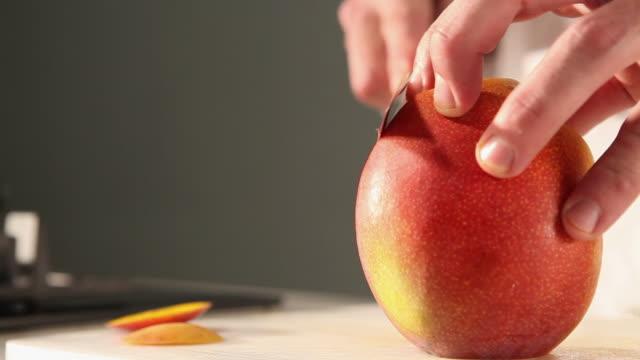 ms food chef chopping mango / sao paulo, brazil - mango stock videos & royalty-free footage