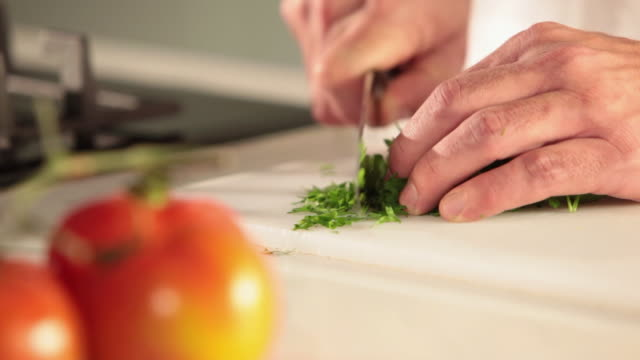ms food chef chopping parsley / sao paulo, brazil - chopping stock videos & royalty-free footage