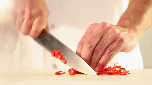 MS Food chef chopping red chilly pepper / Sao Paulo, Brazil