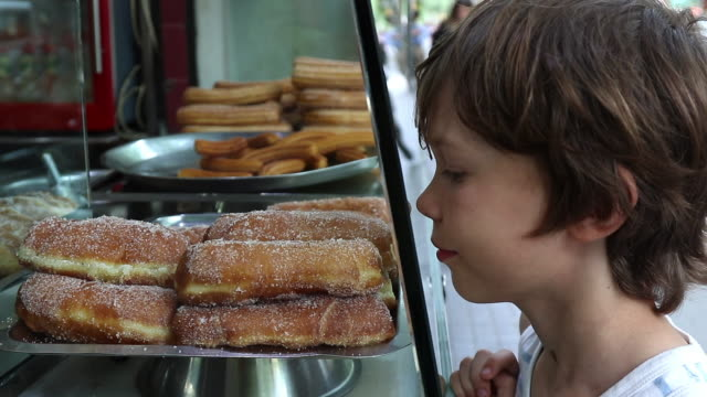 food, child greedily looks at donuts - greed stock videos & royalty-free footage