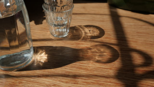 food cinemagraphs: tap water wiggling in a jar - wood grain stock videos and b-roll footage