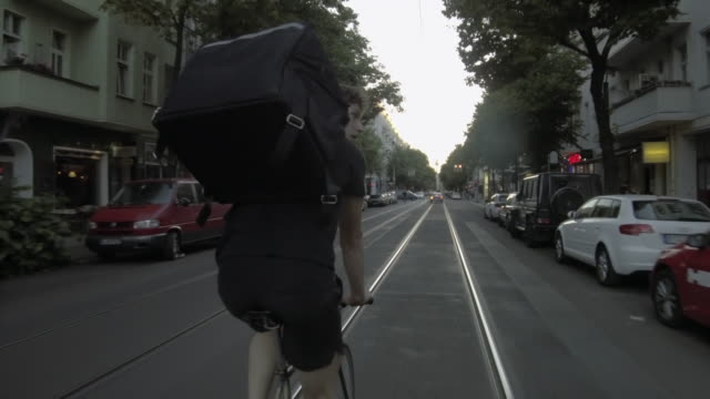 food courier riding through berlin - dolly shot stock videos & royalty-free footage