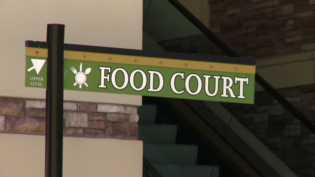 food court sign with escalator in background. - food court stock videos and b-roll footage