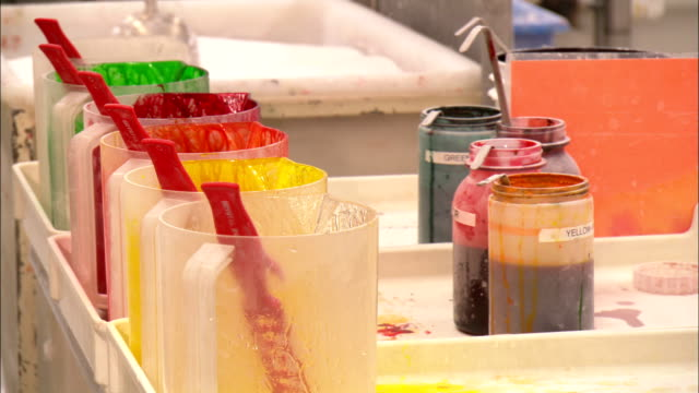 food dyes and sugar occupy a table in a jellybean factory. - jellybean stock videos & royalty-free footage