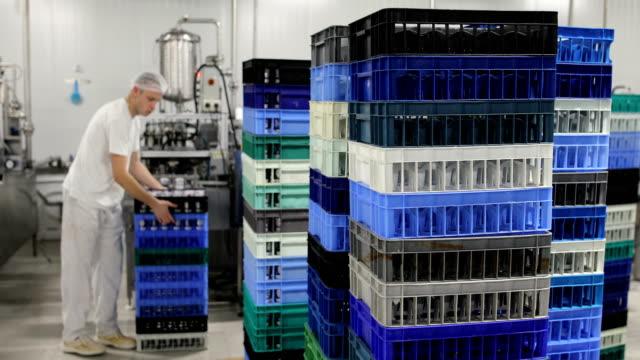 food factory.the worker packs plastic glasses of yogurt - dairy factory stock videos & royalty-free footage