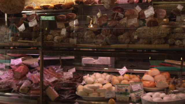 ms ds. food for sale in delicatessen / bologna, italy - display cabinet stock videos & royalty-free footage
