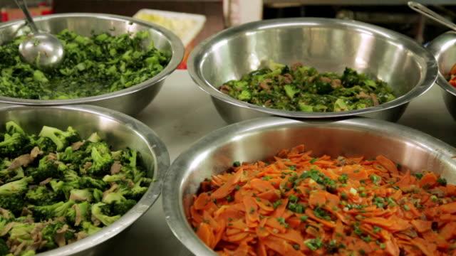 stockvideo's en b-roll-footage met ms pan food in bowls / shenzhen, guangdong, china - zij aan zij