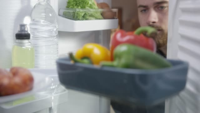 food in the refrigerator - open refrigerator stock videos & royalty-free footage