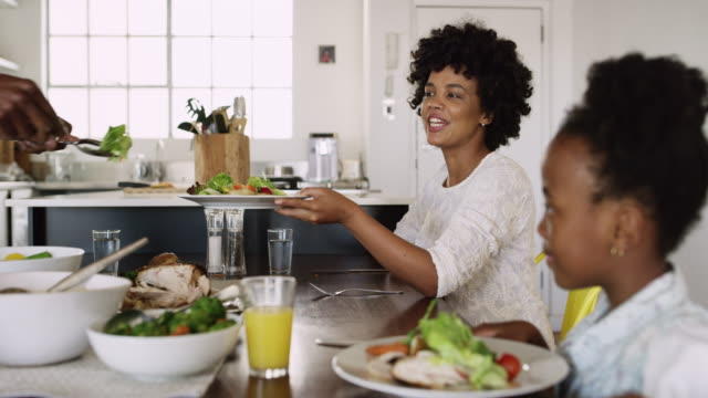 food is best served with family - eating stock videos & royalty-free footage