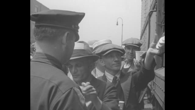 food line for reporters / police hand out sandwiches, coffee and danish from a train car / men standing in line / hats worn have press pass in band... - documentary footage stock videos & royalty-free footage