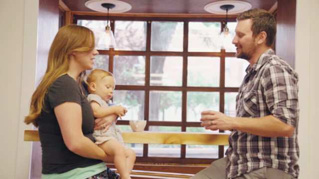 food mishaps: baby grabs coffee - spilling stock videos and b-roll footage