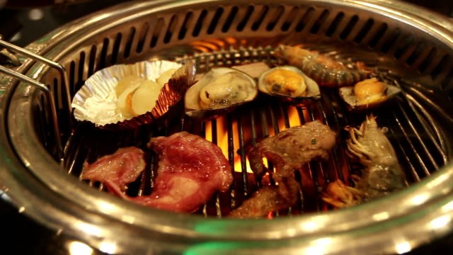 Food on Korean BBQ grill Video HD.