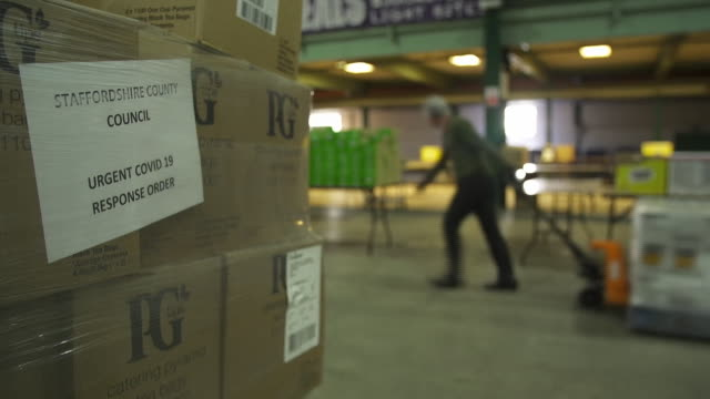 food parcels being packaged and delivered for the vulnerable during the coronavirus crisis by staffordshire county council - packing stock videos & royalty-free footage
