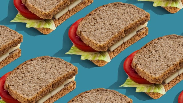 food pattern on color background. - sandwich stock videos & royalty-free footage