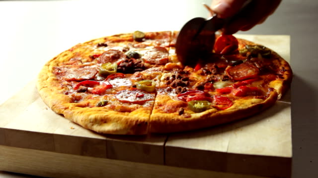 food pizza slicing  fo - part of stock videos & royalty-free footage
