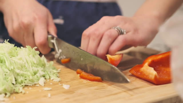 Food Preparation Cutting Vegetable Cabbage and Bell Pepper