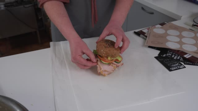 Food preparation in traditional UK Butchers shop fresh sandwich made to order.