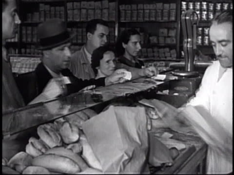 food shops people buying bread cu tins of biscotti people at food counter - 1940 stock videos & royalty-free footage