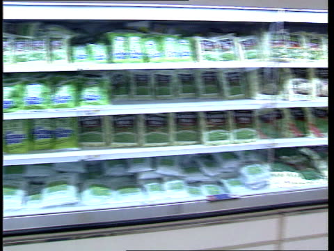 food shortages; itn well-stocked frozen vegetable shelves in supermarket r-l - frozen food stock videos & royalty-free footage