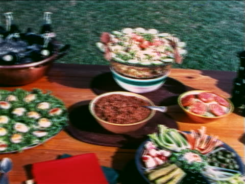 1960 pan food, sodas, dishes + silverware on picnic table outdoors / travelogue - 1960 stock videos & royalty-free footage