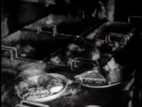 food spooned onto plate / soldiers moving through mess hall line - us navy stock videos & royalty-free footage