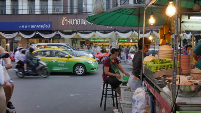 food stall and traffic on yaowarat road, chinatown, bangkok, thailand, southeast asia, asia - concession stand stock videos and b-roll footage