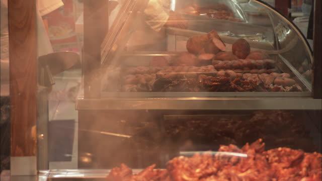 cu food stall selling cooked meat, beijing, china - skåp med glasdörrar bildbanksvideor och videomaterial från bakom kulisserna