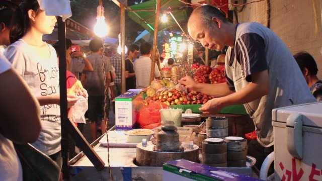 ms food stalls in night market/xian,shaanxi,china - concession stand stock videos and b-roll footage