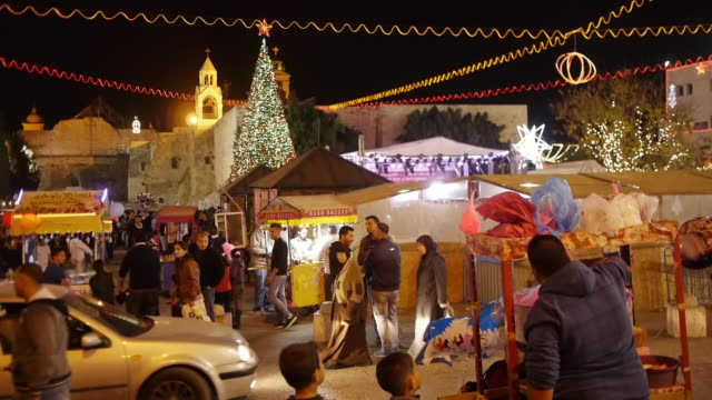 food stands at christmas fair at manger square, church of the nativity in bethlehem, westbank, palestine. close shot. - palestinian territories stock videos and b-roll footage