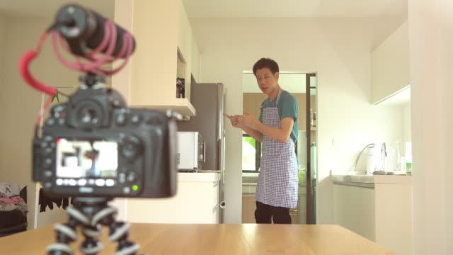 Food stylist recording video food preparation