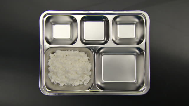 food tray with changing rice and side dishes - school dinner stock videos & royalty-free footage