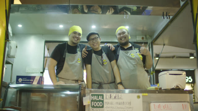 food truck chefs posing for camera - chef stock videos & royalty-free footage