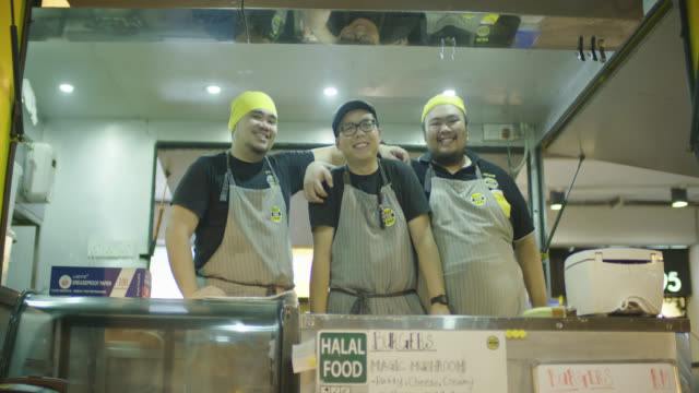 food truck chefs posing for camera - cultura malesiana video stock e b–roll