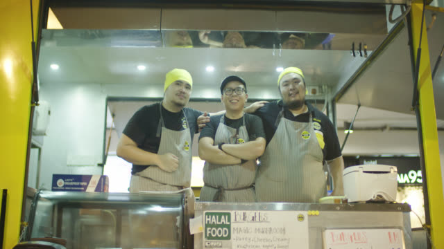 food truck chefs posing for camera - malaysian culture stock videos & royalty-free footage