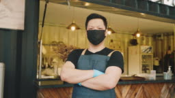 Food truck owner wearing protective face mask